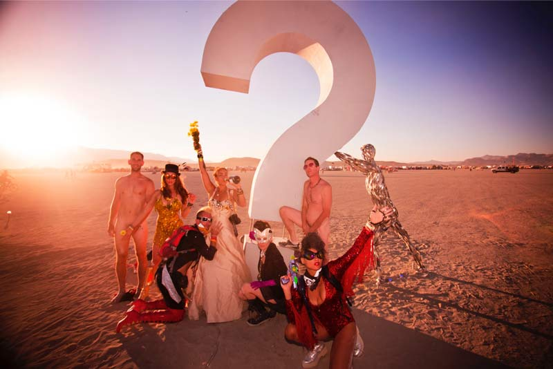 Burning-Man-2015-88;-Robin-Stephan's-Wedding-Street-Life-Group-Shot-Sunset-Playa-Question-Mark-(Identity-Awareness)-Naked